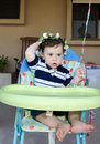 Baby boy first birthday cute holding his bouquet Royalty Free Stock Image