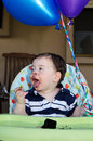 Baby boy first birthday cute messy eating a cake at his party Royalty Free Stock Photos