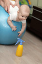 Baby boy on fitness ball Royalty Free Stock Images