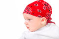 Baby boy in headscarf portrait isolated on the white background Stock Photo