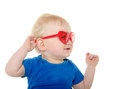 Baby boy with heart shaped sunglasses cute month old blond hair and blue shirt wearing on white background Royalty Free Stock Photography