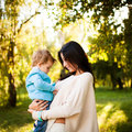 Baby boy in the park with his mum Royalty Free Stock Photo