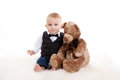 Baby boy and his teddy bear Stock Photo