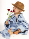 Baby Boy Holding Pretty Flower Stock Image