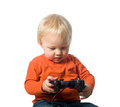 Baby boy holding a video game controller isolated on white Stock Image