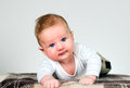 Baby boy holds raised head is holding happy and amazed child Royalty Free Stock Images