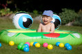 Baby boy and kids rubber pool laughing sitting in a Stock Images