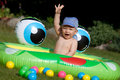Baby boy and kids rubber pool laughing sitting in a hand up Royalty Free Stock Image