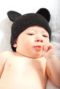 Baby boy with knitted black cap ears Stock Photos