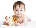 Baby boy with lamb toy lying on tummy Royalty Free Stock Images