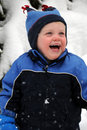 Baby boy laughing in snow Royalty Free Stock Image