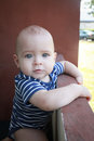Baby boy leaning on railing by hotel Royalty Free Stock Photo