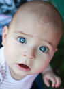 Baby boy looking shy, surprised or shocked Royalty Free Stock Photo