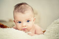 Baby boy lying and looking into camera Royalty Free Stock Photos
