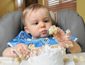Baby boy makes mess of cake Royalty Free Stock Photos