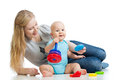 Baby boy and mother playing together Royalty Free Stock Photos