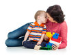 Baby boy mother playing together construction set toy Stock Images