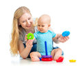 Baby boy and mother playing together with toy Royalty Free Stock Photography