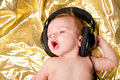 Baby boy with music from headphones Royalty Free Stock Photos