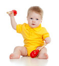 Baby  boy with musical toys on white Royalty Free Stock Photo