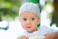 Baby boy outdoor portrait with blue eyes at the playground Stock Photography