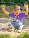 Baby boy playing cute throwing sand with both hands to play Royalty Free Stock Photo