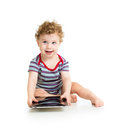 Baby boy playing with digital tablet on white Stock Image