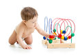 Baby boy playing with educational toy color Royalty Free Stock Photography