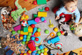 baby boy playing with his toys on the floor Royalty Free Stock Photo