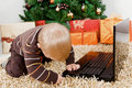 Baby boy playing with a laptop at christmas Royalty Free Stock Photo