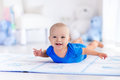 Baby boy playing and learning to crawl Royalty Free Stock Photo