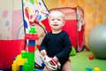 Baby boy playing in nursery Royalty Free Stock Image