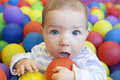Baby boy playing in the playground balls pool Royalty Free Stock Photo