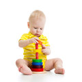 Baby boy playing pyramid toy Royalty Free Stock Photo