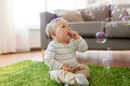 Baby boy playing with soap bubbles at home