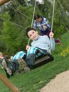 image photo : Baby boy playing on swing