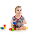 Baby boy playing toy blocks on white background Stock Photos