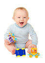 Baby boy playing with toy cars laughing funny isolated on white background Stock Images