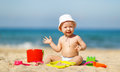 Baby boy playing with toys and sand on beach Royalty Free Stock Photo