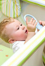 Baby boy in playpen Stock Photos