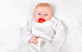 Baby boy portrait with pacifier on the white blanket Stock Photo
