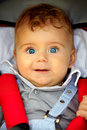Baby boy portrait in stroller Stock Photography