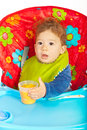 Baby boy ready to eat sitting in chair and being for vegetables puree Royalty Free Stock Photography
