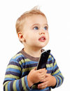 Baby boy with remote Royalty Free Stock Photos