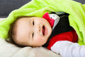 Baby boy rest lying on the bed Royalty Free Stock Photos