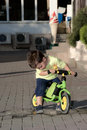 Baby boy riding on his first bike without pedals months old child learning to ride and balance two wheeler with Royalty Free Stock Photos