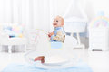 Baby boy in rocking horse toy Royalty Free Stock Photo