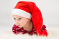 Baby boy in santa claus cap with big eyes Royalty Free Stock Photos