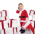 Baby boy in Santa Claus costume with phone Royalty Free Stock Images