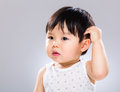 Baby boy scratch head with gray background Royalty Free Stock Photography